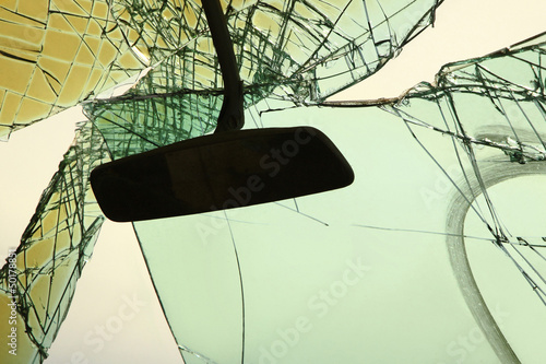 Rearview mirror and broken windshield glass