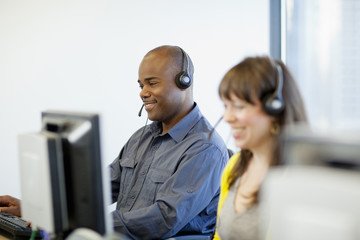 Business people working on computers in call center