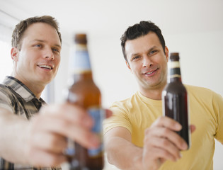 Men toasting together with beer