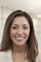 Smiling mixed race businesswoman