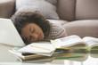 Tired Hispanic girl sleeping on laptop