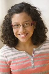Smiling Hispanic girl in eyeglasses