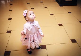Portrait Baby dressed in pink dress