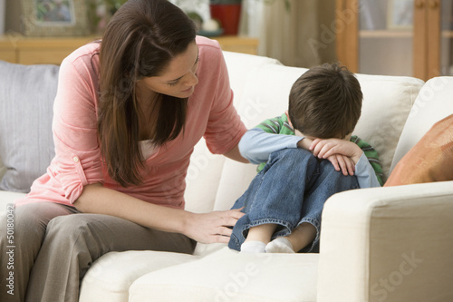 Caucasian mother comforting son