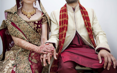 Bride and groom in traditional Indian wedding clothing