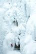 Caucasian man climbing ice