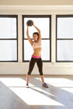 Caucasian woman exercising with ball