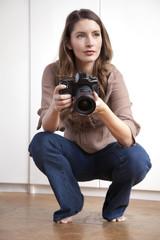 Caucasian woman holding camera