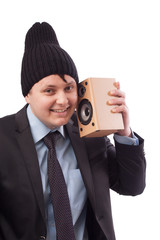 Cool dude in a suit and hat with a speaker