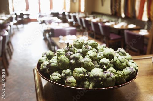 Close up of artichokes in bowl in restaurant