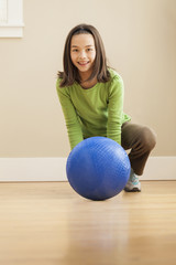 Smiling girl playing with ball