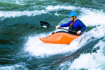 Caucasian boy kayaking on river
