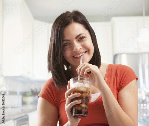Caucasian woman drinking soda
