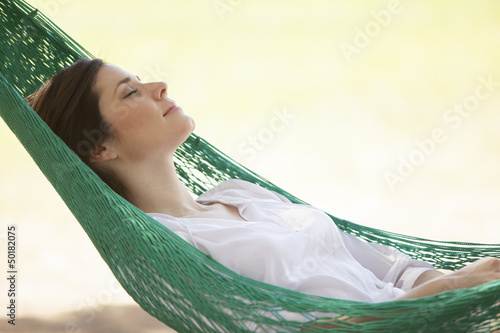 Cute young woman napping during her outdoor vacation trip