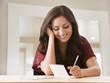 Mixed race woman writing card