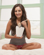 Mixed race woman eating Chinese food from carton