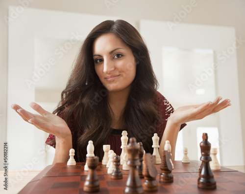 Mixed race woman playing chess
