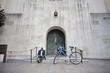 Businessman sitting on steps near bicycle