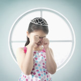 Chinese girl in tiara crying