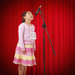 Chinese girl talking into microphone