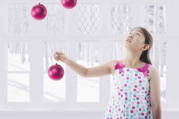 Chinese girl holding Christmas ornament