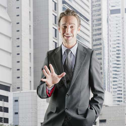 Hispanic businessman standing outdoors