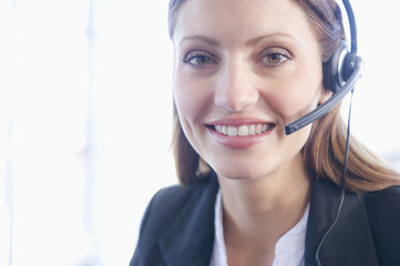 Hispanic businesswoman in headset