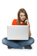 Young woman sitting on the floor using her laptop