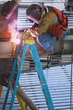 Construction worker welding metal