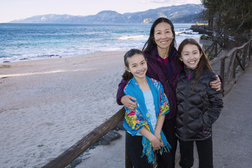 Japanese family standing on beach