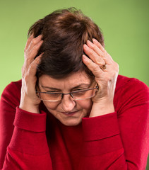 Mature woman suffering from a headache