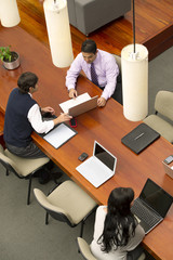 Hispanic businessmen having meeting in conference room