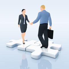 Geschäftsleute auf Puzzle-Teilchen - Hände schütteln