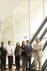 Hispanic business people standing together