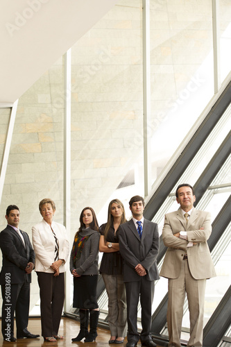 Hispanic business people standing together
