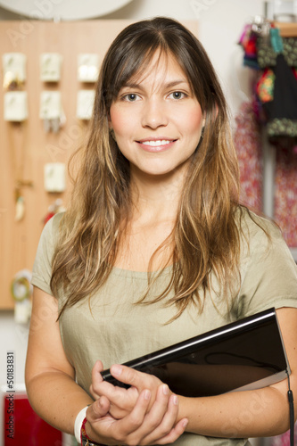 Hispanic woman working in store