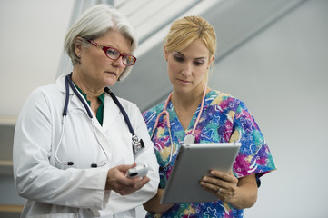 Caucasian nurse and doctor using digital tablet