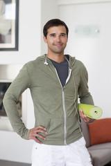 Mixed race man holding yoga mat