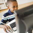 Black boy using computer