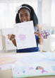 Black girl holding drawing