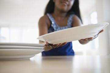 Black girl setting the table