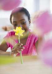 Black girl smelling flower
