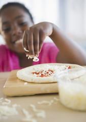 Black girl making pizza