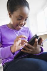 Black girl using digital tablet