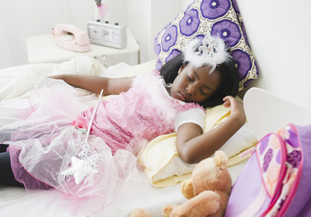 Black girl sleeping in fairy costume