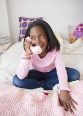 Black girl talking on telephone