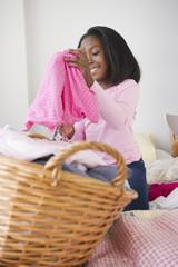 Black girl folding laundry