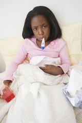 Sick Black girl taking temperature