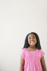 Smiling Black girl looking up