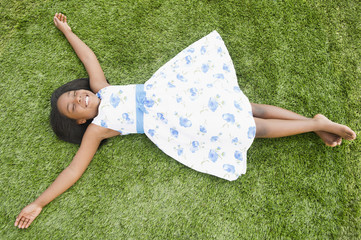 Black girl laying in grass